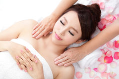 Woman smile getting massage on shoulder Royalty Free Stock Photo