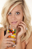 Woman smile glass of candy Royalty Free Stock Photos