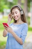 Woman listen music Stock Image
