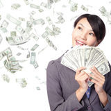 Woman smile happy with handful of money Stock Photo