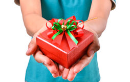Woman smile and hold gift box in hands Royalty Free Stock Photos