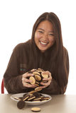 Woman smile lots of cookies Stock Image