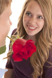 Woman smile man rose in mouth Royalty Free Stock Photography