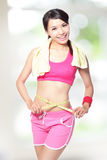 Woman smile measuring waist after sport Royalty Free Stock Image