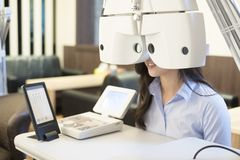 Woman with optometry. Woman smile with optometry in the optical shop Royalty Free Stock Images