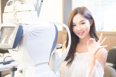 Woman with optometry. Woman smile with optometry in the optical shop Stock Photo