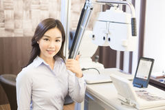 Woman smile with optometry. Woman smile and thumb up with optometry in the optical shop Royalty Free Stock Photos