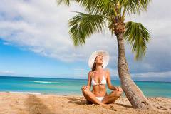 Woman smile palm tree beach. Woman in white bikini and hat smiling under palm tree on tropical beach Stock Image