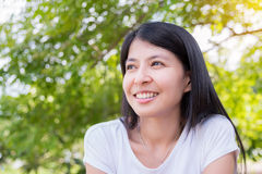 Woman smile in park Royalty Free Stock Photography
