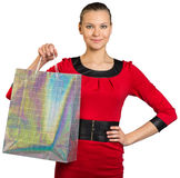 Woman with smile showing shopping bag Royalty Free Stock Photo