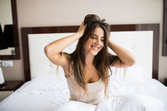 Woman smile and stretching in bed. After wake up Royalty Free Stock Photos