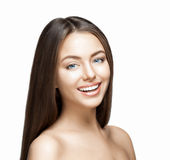 Woman smile. Teeth whitening. Dental care. Portrait of attractive caucasian smiling woman brunette on gray background, studio shot toothy smile face long hair Royalty Free Stock Image