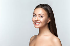 Woman smile. Teeth whitening. Dental care. Portrait of attractive caucasian smiling woman brunette on gray background, studio shot toothy smile face long hair Royalty Free Stock Photos