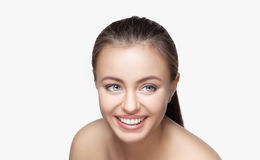 Woman smile. Teeth whitening. Dental care. Portrait of attractive caucasian smiling woman brunette on gray background, studio shot toothy smile face long hair Stock Photo
