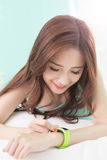 Woman Smile use smart watch Royalty Free Stock Photos