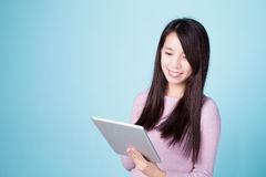 Woman smile use tablet pc Stock Images