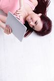 Woman smile using tablet pc Royalty Free Stock Images