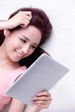 Woman smile using tablet pc Royalty Free Stock Image