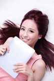 Woman smile using tablet pc Stock Image