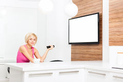 Woman smile watching tv hold remote control Royalty Free Stock Photos