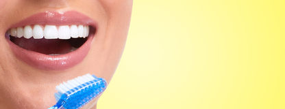 Woman smile. Young woman smile with toothbrush dental care background Stock Photo