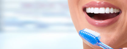 Woman smile. Young woman smile with toothbrush dental care background Royalty Free Stock Photo