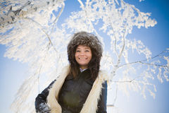 Woman smiles at the background of snow-covered bra Royalty Free Stock Photos
