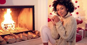 Woman smiles at camera while wearing sweater stock footage