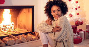 Woman smiles at camera while wearing sweater Royalty Free Stock Photos