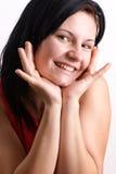 woman smiles into a digital camera Stock Photo