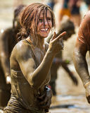 Woman smiles at the dirty dash Royalty Free Stock Photography