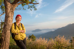 Woman smiles on the hill Royalty Free Stock Image