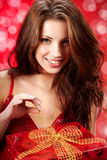 Woman smiles and holding a magic gift Stock Photos