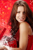 Woman smiles and holding a magic gift in packing Royalty Free Stock Photo