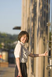 Woman Smiles While Opening a Door - Vertictal Stock Images