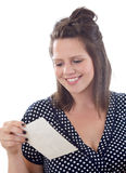 Woman smiles while reading a note Stock Images
