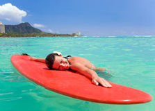 Woman smiles on surfboard Stock Images