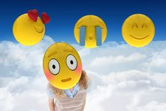 Woman with smiley on her face against cloudy background Stock Images