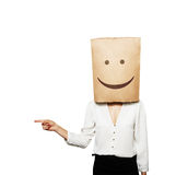 Woman with smiley paper bag Stock Photo