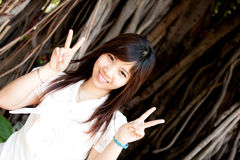 Woman smiling. Smiling young thai girl and white hat in travel Stock Images