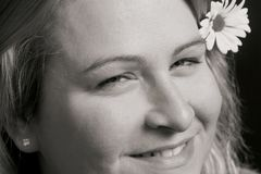 Woman smiling. Close up of a woman smiling with a flower in her hair Royalty Free Stock Photo