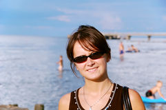 Woman smiling. At sea background Royalty Free Stock Photography