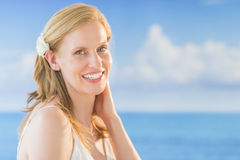 Woman Smiling Against Sea At Beach Stock Images