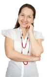 Woman smiling against white Stock Photography