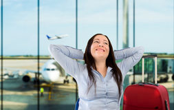 Woman smiling at the airport Stock Image