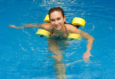 Woman smiling in aqua aerobics royalty free stock images