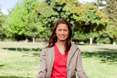 Woman smiling in an area surrounded by grass Stock Photography