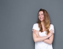 Woman smiling with arms crossed Stock Photos