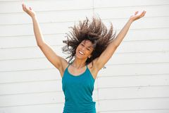 Woman smiling with arms spread open Stock Image