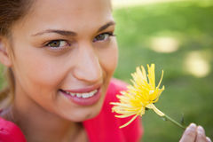 Woman smiling as she looks upwards Royalty Free Stock Photos